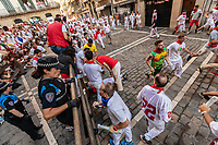 Europe,Spain,Pamplona,San Firmin festival 2018, Encierro, injured boy from the  bulls running helped by his friend