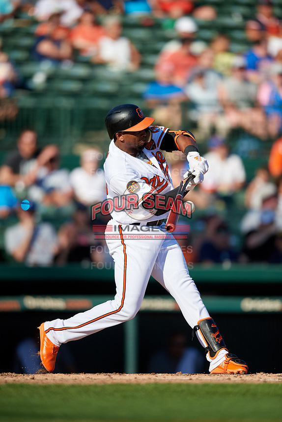 Baltimore Orioles right fielder Yusniel Diaz (80) hits an infield single while breaking his bat during a Grapefruit League Spring Training game against the Detroit Tigers on March 3, 2019 at Ed Smith Stadium in Sarasota, Florida.  Baltimore defeated Detroit 7-5.  (Mike Janes/Four Seam Images)