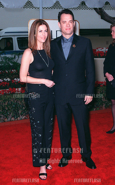 "24JAN99:  Actor TOM HANKS & actress wife RITA WILSON at the Golden Globe Awards in .Beverly Hills. He was nominated for Best Actor in a Movie (Drama) for ""Saving Private Ryan""..© Paul Smith/Featureflash"
