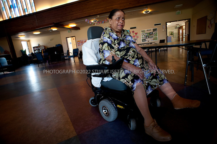 7/24/2009--Seattle, WA, USA..Connie Baugh, 77, at ElderHealth Northwest's South Branch adult day health center. Connie will likely lose benefits that pay for her compression socks that prevent sores and blood circulation problems. Here Connie wears one of her compression socks on her right leg while her left leg is bandaged because of sores...Washington State, a Democratic liberal stronghold, has long been a proponent of the widest possible public access to health care. But state officials there are among those around the country who warn that the direction health care reform seems to be taking among the Democrats in Washington, D.C., could impose new strain on state-funded Medicaid services, with no new federal money to help ease the burden. Here's an on-the-ground look at how Medicaid is already spread thin in Washington State -- and what officials there worry might happen under if Congress passes health care legislation in any of its current forms....©2009 Stuart Isett. All rights reserved.