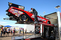 Feb 28, 2016; Chandler, AZ, USA; Crew members load the car of NHRA funny car driver Cruz Pedregon onto the hauler during the Carquest Nationals at Wild Horse Pass Motorsports Park. Mandatory Credit: Mark J. Rebilas-