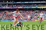 Sean O'Shea, Kerry is tackled by Conor Meyler, Tyrone during the All Ireland Senior Football Semi Final between Kerry and Tyrone at Croke Park, Dublin on Sunday.