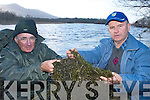 At Ross Castle on Tuesday DJ Riordan and Tom Lyne display the Canadian pond weed which is choking Killarney Lake..