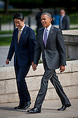 President Barack Obama and Prime Minister Shinzo Abe of Japan talk as they walk to visit the Lincoln Memorial in Washington, District of Columbia, U.S., on Monday, April 27, 2015.  Prime Minister Abe is in the Nation's Capital to discuss a range of economic, security, and global issues, including progress on the Trans Pacific Partnership, Japan's expanding role in the Alliance, and climate change.<br /> Credit: Pete Marovich / Pool via CNP