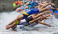 07 JUL 2012 - PARIS, FRA - Competitors, including Alexandre Maire (GT Vesoul Haute-Saone) (nearest to camera), dives into the water at the start of the elite men's French Grand Prix round during the 2012 Triathlon de Paris beside the Pont d'Lena, Paris, France .(PHOTO (C) 2012 NIGEL FARROW)