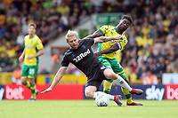 Alexander Tettey of Norwich City challenges Adam Clayton of Middlesbrough for the ball during Norwich City vs Middlesbrough, Sky Bet EFL Championship Football at Carrow Road on 15th September 2018
