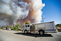 Santa Barbara, California - Fire engine drives along Foothill rd at Calle Laureles in   direction of Mission Canyon during Jesusita fire. Wednesday May 6, 2009