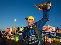 Feb 8, 2015; Pomona, CA, USA; NHRA funny car driver Matt Hagan celebrates after winning the Winternationals at Auto Club Raceway at Pomona. Mandatory Credit: Mark J. Rebilas-USA TODAY Sports