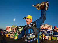 Feb 8, 2015; Pomona, CA, USA; NHRA funny car driver Matt Hagan celebrates after winning the Winternationals at Auto Club Raceway at Pomona. Mandatory Credit: Mark J. Rebilas-USA TODAY Sports