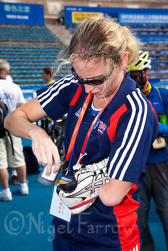 09 SEP 2011 - BEIJING, CHN - TRI-4 competitor Clare Cunningham (GBR) prepares her running shoes ahead of the start of the 2011 ITU World Paratriathlon Championships (PHOTO (C) NIGEL FARROW)