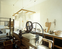 The original laundry room at Erddig Hall is furnished with an 18th century washing machine