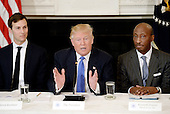 United States President Donald Trump (C) speaks as Jared Kushner (L) , White House Senior Adviser, Kenneth Frazier (R), Chairman and CEO, Merck look on during a  listening session with manufacturing CEOs  in the State Dining Room  of the White House on February 23, 2017 in Washington, DC. <br /> Credit: Olivier Douliery / Pool via CNP