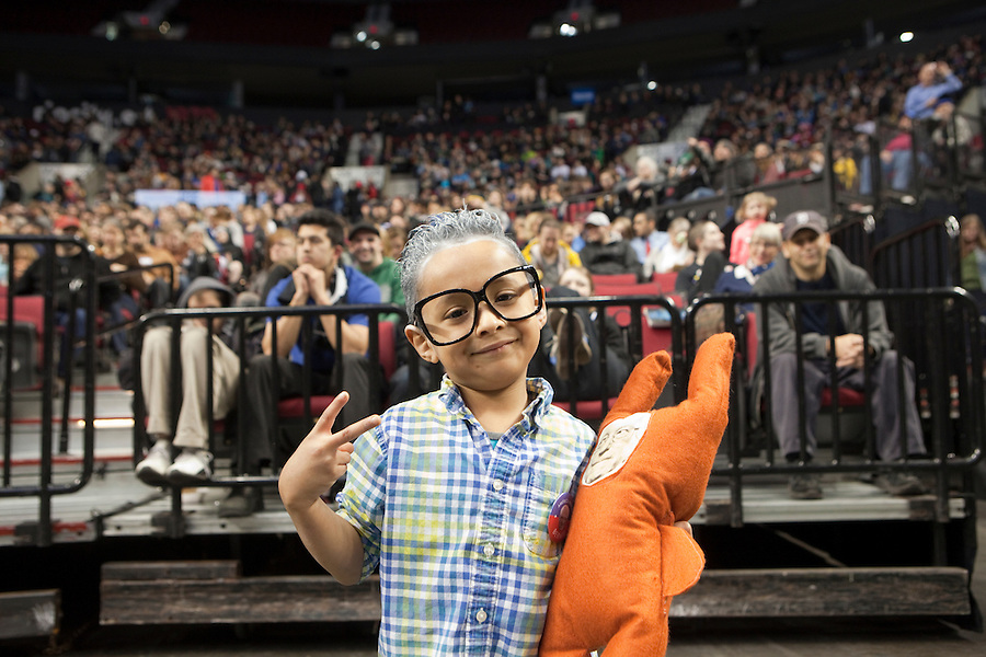 Six year old Jesus Marques is dressed up as a miniBernie Sanders at a political rally in Portland, Oregon Friday March 25, 2016. Sanders spoke to a crowd of more than eleven thousand about a wide range of issues, including getting big money out of politics, his plan to make public colleges and universities tuition-free, combating climate change and ensuring universal health care.  Photo by Natalie Behring