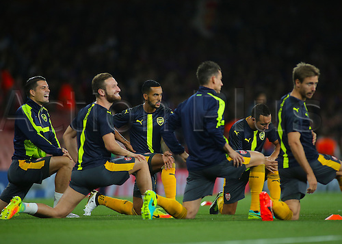 28.09.2016. Emirates Stadium, London, England. UEFA Champions League Football. Arsenal versus FC Basel. Arsenal Forward Theo Walcott (centre) warms up with team mates