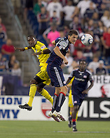 Columbus Crew defender Shaun Francis (29) and New England Revolution midfielder Marko Perovic (29) battle for head ball. The New England Revolution tied Columbus Crew, 2-2, at Gillette Stadium on September 25, 2010.