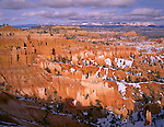 Bryce Canyon National Park, UT<br /> A spring snow covers the floor of the Bryce Amphitheater from Sunset Point with Boat Mesa and Sinking Ship in the distance