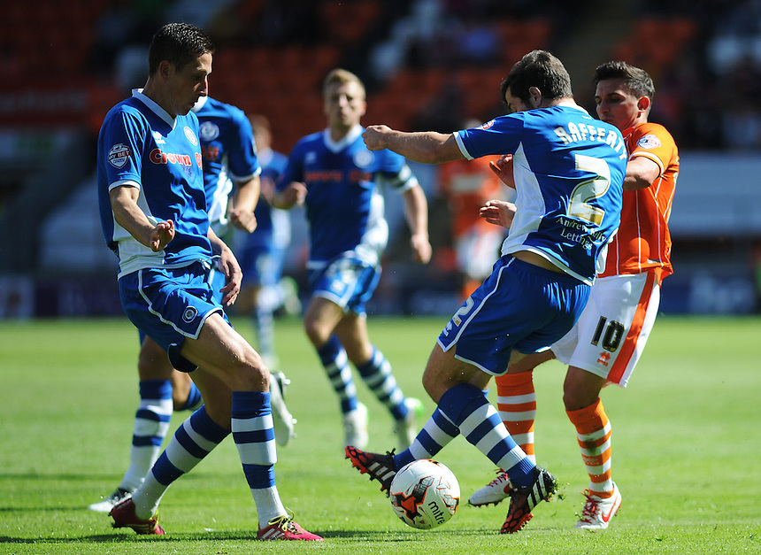 Blackpool's Jack Redshaw is tackled by Rochdale's Joe Rafferty<br /> <br /> Photographer Kevin Barnes/CameraSport<br /> <br /> Football - The Football League Sky Bet League One - Blackpool v Rochdale - Saturday 15th August 2015 - Bloomfield Road - Blackpool<br /> <br /> &copy; CameraSport - 43 Linden Ave. Countesthorpe. Leicester. England. LE8 5PG - Tel: +44 (0) 116 277 4147 - admin@camerasport.com - www.camerasport.com