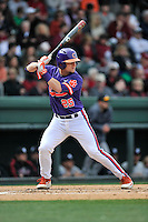 Catcher Chris Okey (25) of the Clemson Tigers bats in the Reedy River Rivalry game against the South Carolina Gamecocks on Saturday, March 5, 2016, at Fluor Field at the West End in Greenville, South Carolina. Clemson won, 5-0. (Tom Priddy/Four Seam Images)