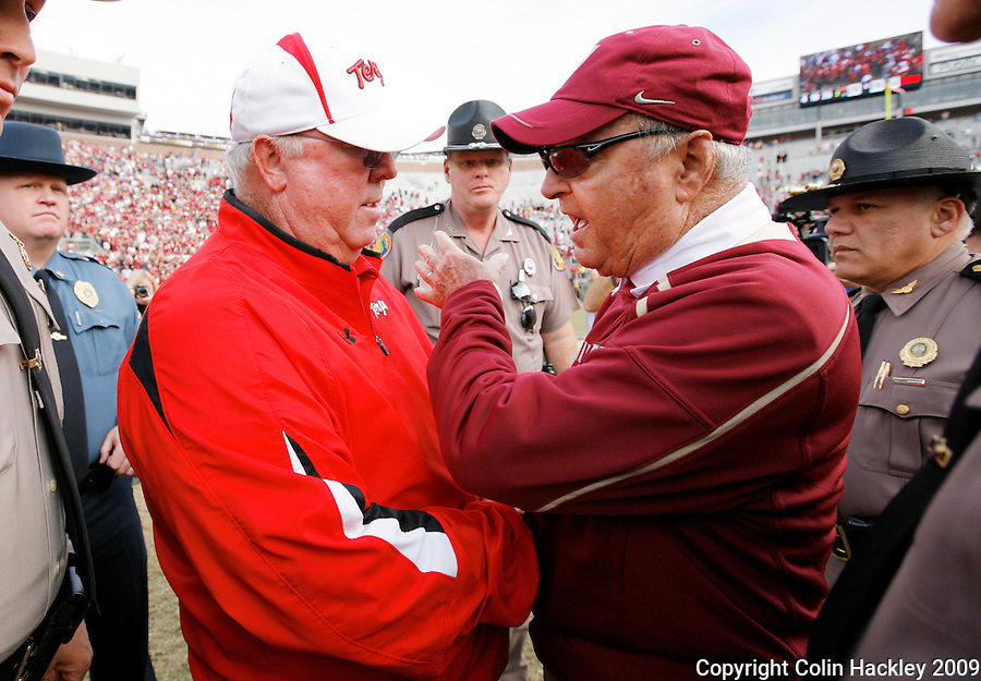 TALLAHASSEE, FL 11/21/09-FSU-MARY FB09 CH79-Florida State Head Coach Bobby Bowden, right, talks with Maryland Head Coach Ralph Friedgen after the Seminoles beat the Terrapins 29-26 Saturday at Doak Campbell Stadium in Tallahassee. .COLIN HACKLEY PHOTO