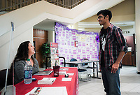 NWA Democrat-Gazette/CHARLIE KAIJO Olga Murcia, University of Arkansas admissions counselor for Transfer Central, (from left) talks to Dinesh Hingoo of Rogers about transfer requirements, Monday, October 8, 2018 at the Northwest Arkansas Community College in Rogers.<br /><br />Murcia will be at NWACC against on October 22nd from 9am-12pm to help students with their transfer requirements