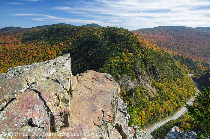 Dixville Notch State Park in Dixville, New Hampshire USA from Table Rock during the autumn months. Route 26 is in view.