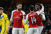 Olivier Giroud, Theo Walcott and Danny Welbeck of Arsenal celebrates going 4-0 up after an own goal during the UEFA Europa League match between Arsenal and FC BATE Borisov  at the Emirates Stadium, London, England on 7 December 2017. Photo by David Horn.