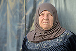 A woman in a settlement of Syrian refugees in Minyara, a village in the Akkar district of northern Lebanon. Lebanon hosts some 1.5 million refugees from Syria, yet allows no large camps to be established. So refugees have moved into poor neighborhoods or established small informal settlements in border areas. International Orthodox Christian Charities, a member of the ACT Alliance, provides support for families in this settlement.
