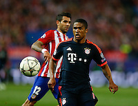 Atletico Madrid´s Juanfran and Bayer Munich´s Douglas Costa