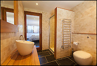BNPS.co.uk (01202 558833)<br /> Pic: Jackson-Stops/BNPS<br /> <br /> ****Please use full byline****<br /> <br /> One of the three plush bathrooms.<br /> <br /> A stunning cliff-top house has grown into a 1.25 million pounds property after it was built on a disused allotment.<br /> <br /> Jamie and Zoe McLintock forked out &pound;80,000 for the overgrown plot of land eleven years ago because it was atop a cliff along Devon's craggy coastline.<br /> <br /> The enterprising couple spent a further &pound;600,000 and three years of their time building the beautiful five-bedroom pad.<br /> <br /> But they are now set to double their money after the incredible property went on the market for a whopping &pound;1.25 million with estate agents Jackson-Stops.<br /> <br /> The white-washed three-storey house is perched on top of 100ft cliffs overlooking Tunnels Beaches in Ilfracombe, a stretch of private Victorian beach owned by the couple since 2001.