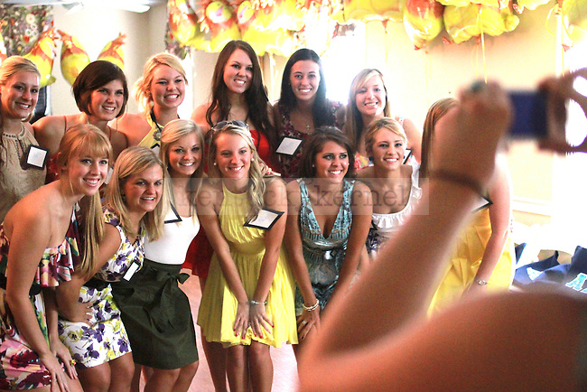 Sisters of the Alpha Delta Pi sorority pose for a picture before their pledge class arrives. They celebrated this year's bid day, honoring their pledge class of 2010, on August 20, 2010.