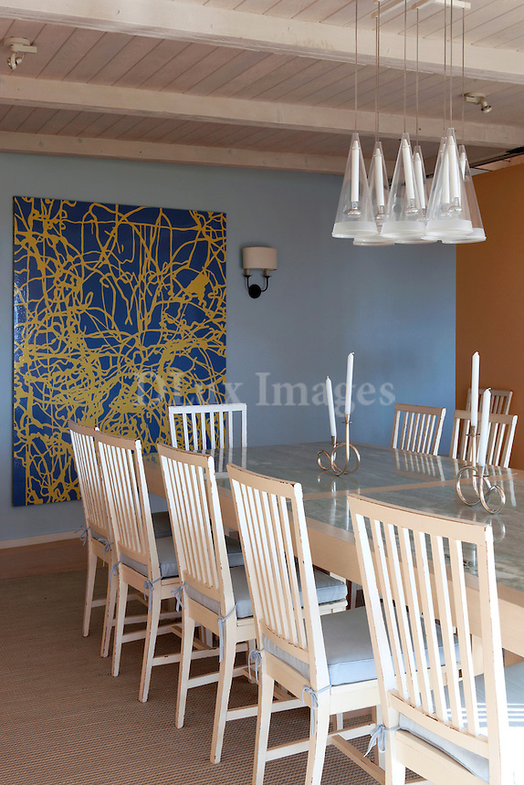 contemporary dining room with painting