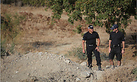 Pictured: Two forensics officers examine the new site in Kos, Greece. Saturday 08 October 2016<br />Re: Police teams led by South Yorkshire Police, searching for missing toddler Ben Needham on the Greek island of Kos have moved to a new area in the field they are searching.<br />Ben, from Sheffield, was 21 months old when he disappeared on 24 July 1991 during a family holiday.<br />Digging has begun at a new site after a fresh line of inquiry suggested he could have been crushed by a digger.
