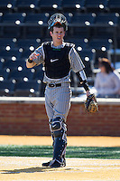 Marshall Thundering Herd catcher Matt Reed (22) on defense against the Georgetown Hoyas at Wake Forest Baseball Park on February 15, 2014 in Winston-Salem, North Carolina.  The Thundering Herd defeated the Hoyas 5-1.  (Brian Westerholt/Four Seam Images)