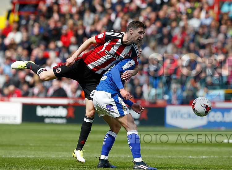 Chris Basham of Sheffield Utd in action with How Rowley of Chesterfield during the English League One match at  Bramall Lane Stadium, Sheffield. Picture date: April 30th 2017. Pic credit should read: Simon Bellis/Sportimage