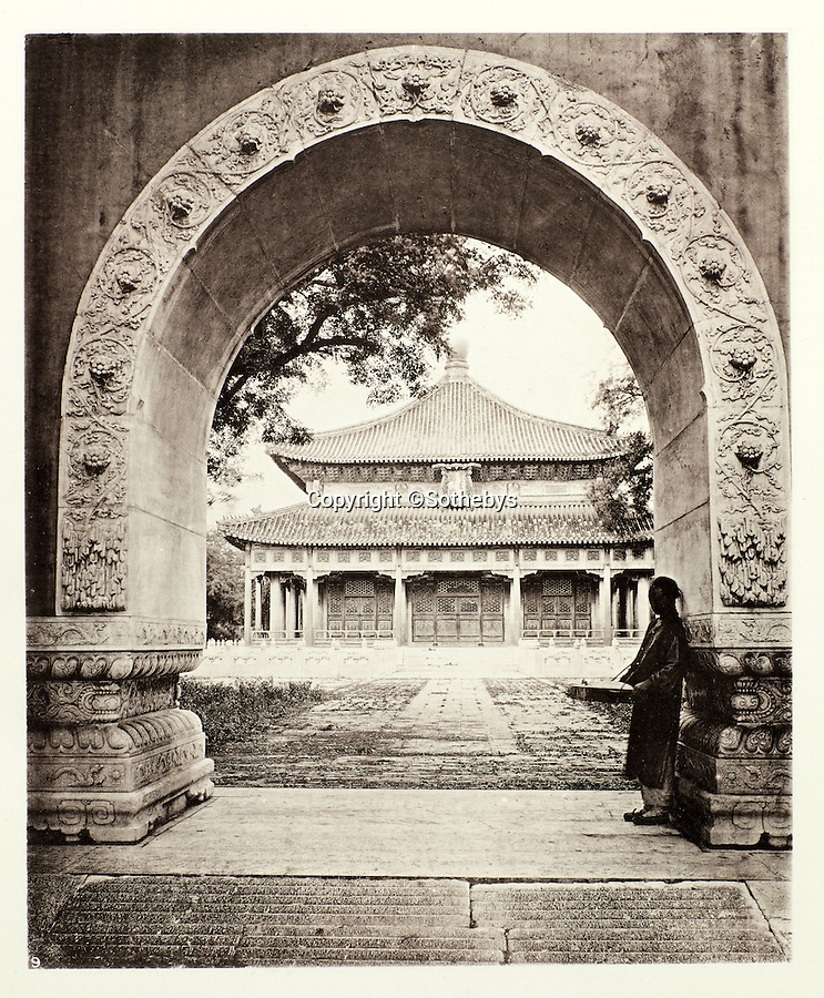 BNPS.co.uk (01202 558833)<br /> Pic: Sothebys/BNPS<br /> <br /> View into the National University in Peking.<br /> <br /> Rare early photographs revealing what life in China looked like for the first time to the 19th century public have emerged 140 years after they were taken. <br /> <br /> The stunning collection - comprising 200 black and white photographs of Far East landscapes and wide-ranging personal portraits of everybody from rural peasants to senior government officials - was the first volume of photos from the region to ever be included in a travel book. <br /> <br /> Produced at a time when camera technology was still in its infancy, they were taken by celebrated Scottish photographer John Thomson between 1873 and 1874 during a 4,000-mile expedition across the country. <br /> <br /> And now one of the last remaining copies of the album still known to exist is set to go under the hammer at Sotheby's in London on November 7 with an estimate of £35,000.