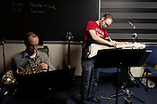 """Jamie Keesecker, left, and Ken Stewart practice a cover version of Katie Perry's """"California Girls"""" as members of the Duke New Music Esemble, Durham, North Carolina, Monday, Nov. 5, 2012."""