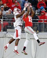 Rutgers Scarlet Knights wide receiver Leonte Carroo (4) steals an interception away fro Ohio State Buckeyes cornerback Gareon Conley (19) to make a first-down catch during the fourth quarter of the NCAA football game at Ohio Stadium in Columbus on Oct. 18, 2014. (Adam Cairns / The Columbus Dispatch)