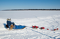 Wade Marrs runs down the bank to the Yukon river at the Grayling checkpoint on during Iditarod 2009