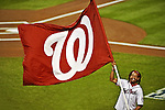 12 October 2012: A member of the Washington Nationals Nat Pack waves the team flag prior to Postseason Playoff Game 5 of the National League Divisional Series against the Washington Nationals at Nationals Park in Washington, DC. The Cardinals stunned the home team Nats with a four-run rally in the 9th inning to defeat the Nationals 9-7 and win the NLDS, moving on to the NL Championship Series. Mandatory Credit: Ed Wolfstein Photo