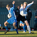 Queen of the South's Daniel Carmichael and City's Mark Torrance challenge ...