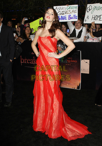 "Ashley Greene.""The Twilight Saga: Breaking Dawn Part 1"" Los Angeles Premiere Held At The Nokia Theatre L.A. Live, Los Angeles, California, USA, 14th November 2011..full length strapless sheer red dress hands on hips long maxi  nails nail varnish polish nude print patterned lace sign banner fans background ""ashley greene gives me blue balls' funny .CAP/ADM/KB.©Kevan Brooks/AdMedia/Capital Pictures."