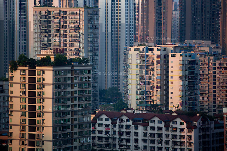 Apartment buildings stand in the Jiangbei District of Chongqing, China.