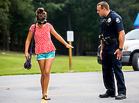 NWA Democrat-Gazette/JASON IVESTER <br /> Bella Vista Police Officer VJ Wilson gives guidance as Audrey Dew, 13, of Bella Vista attempts to walk a straight line on Tuesday, Aug. 4, 2015, while wearing goggles that simulate intoxication at Riordan Hall in Bella Vista. The police department hosted the Night Out event which featured free games and food for families.
