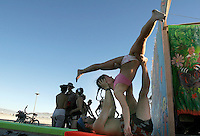 BLACK ROCK CITY, NV - AUGUST 27,2008:  Julia Mueller and Scott Twyster practice couples Yoga at Burning Man Event, August 27, 2008. The annual gathering of participatory art kicked into full gear August 27,2008, as participants from around the world converge in Nevada for the annual art event.
