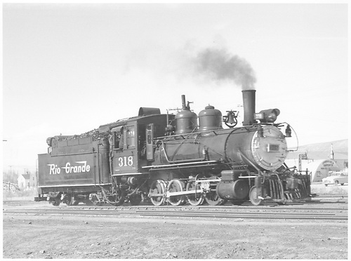 3/4 engineer's-side view of D&amp;RGW #318 at Montrose.<br /> D&amp;RGW  Montrose, CO  Taken by Richardson, Robert W. - 4/16/1952