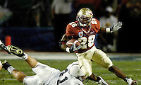 FSU's Lorenzo Booker picks up some extra yardage after pulling in a Drew Weatherford pass in the first quarter of the 2006 FedEx Orange Bowl Game.  Booker generated 69 yards on three catches and one touchdown as part of the Seminole effort to upset the No. 3 Penn State Nittany Lions.