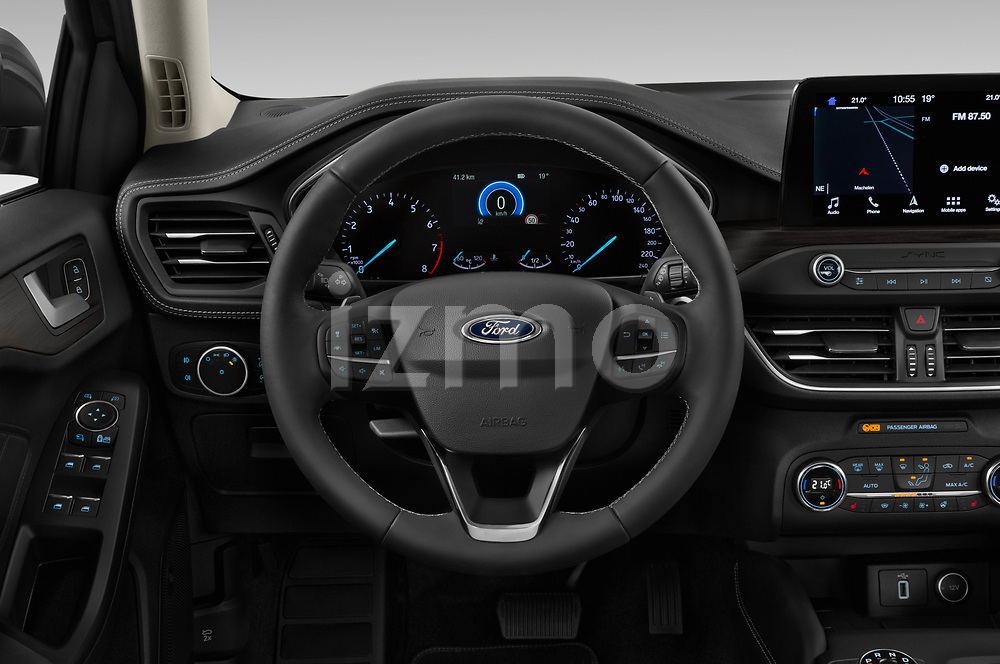 Car pictures of steering wheel view of a 2019 Ford Focus-Clipper Vignale 5 Door Wagon Steering Wheel