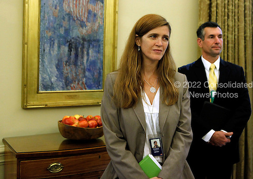 Washington, DC - October 29, 2009 -- National Security Council member Samantha Power, left, stands in the Oval Office during a meeting between United States President Barack Obama and Minister Mentor Lee Kuan Yew of Singapore at the White House, Thursday, October 29, 2009 in Washington, DC. Obama will travel to Asia November 11 on a tour which includes the Asia Pacific Economic Cooperation (APEC) summit and a meeting with leaders of the Association of Southeast Asian Nations (ASEAN) in Singapore. Lee served as prime minister of Singapore between 1959 to 1990, and is regarded as an expert on Asian affairs and US relations with the region.  .Credit: Chip Somodevilla / Pool via CNP