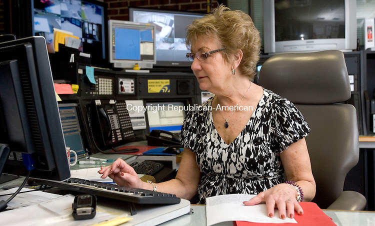 MIDDLEBURY, CT. 29 June 2011-062911SV04--Barbara Bouffard, police dispatcher, works at the station in Middlebury Wednesday. Bouffard retires this week after a 38-year career with the town. She is one of the longest serving town employees.<br /> Steven Valenti Republican-American