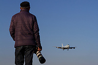 A Japanese man with a telephoto lens on his camera watches a Kawasaki P1 Maritime patrol aircraft with the Japanese Self Defence Force (JSDF) practice landing at Atsugi Air base near Yamato, Kanagawa, Japan. Friday November 30th 2018